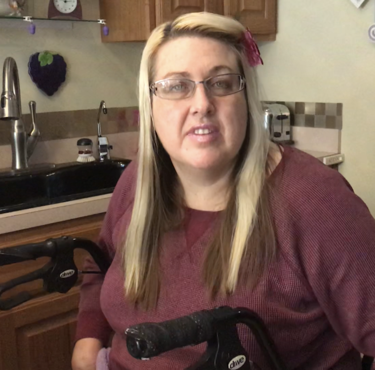 Shirley Thompson of Charlotte has multiple sclerosis and a broken leg. She and her husband are trying to find health care coverage after the state removed her from a Medicaid plan.