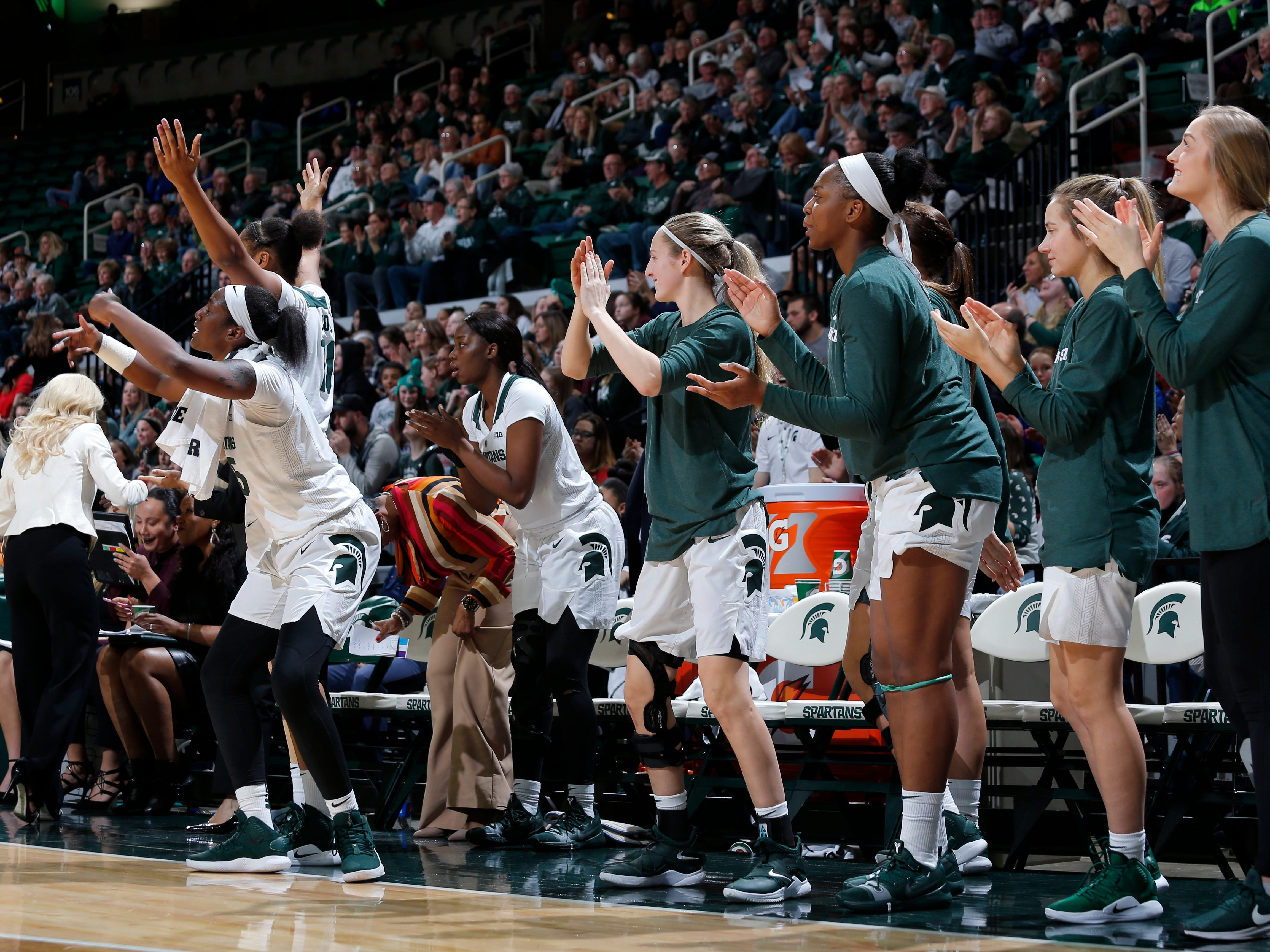 Michigan State's bench celebrates against Maryland, Thursday, Jan. 17, 2019, in East Lansing, Mich.
