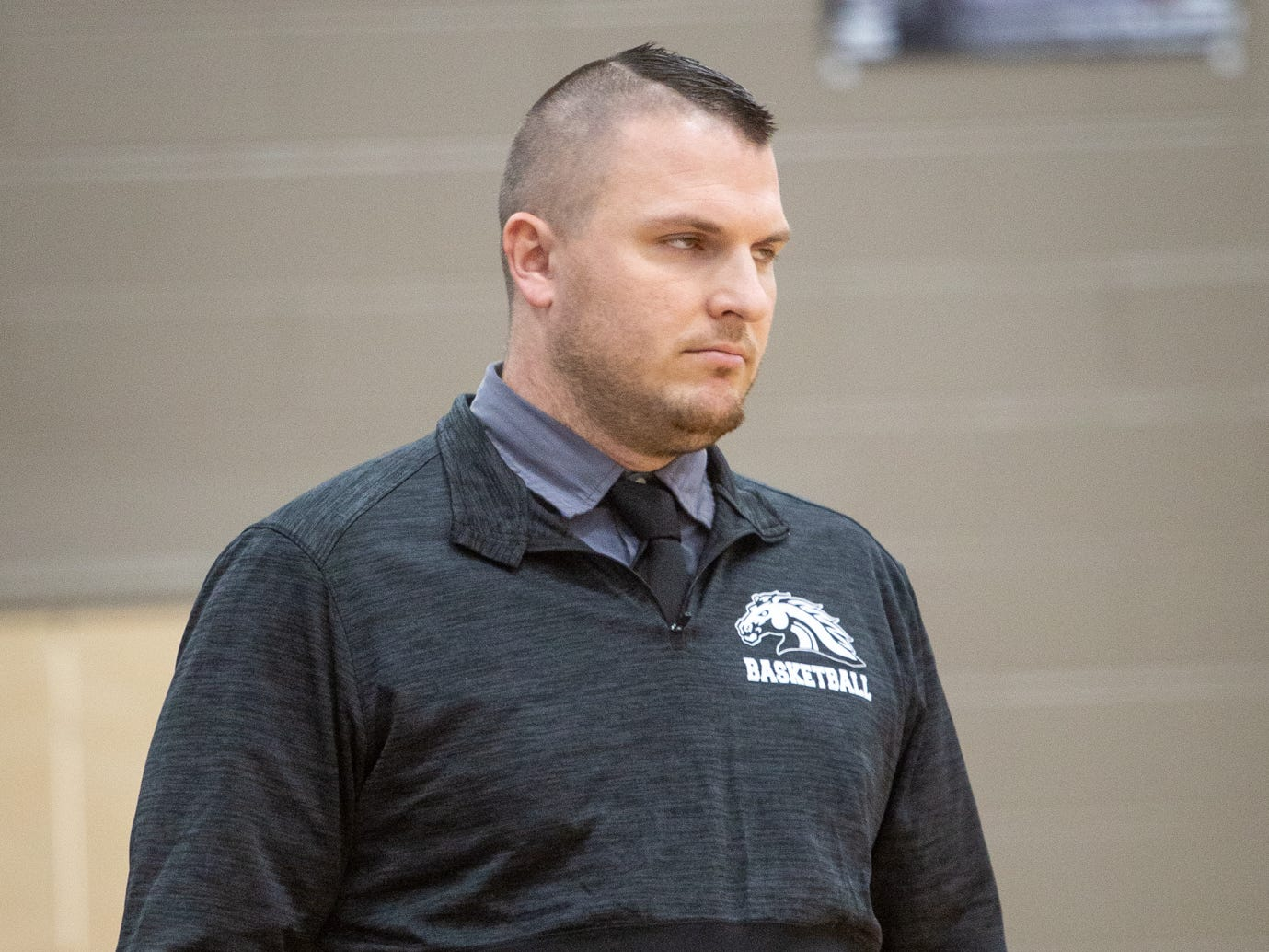 Dansville Coach Cole Feldpausch intensly watching as Pewmo-Westphalia Pirates close score at end of last quarter Thursday,  Jan. 17, 2019.