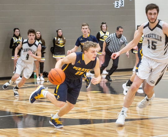Pewamo-Westphalia senior point guard Collin Trieweiler helped lead the Pirates to Jan. 17 win over Dansville. P-W has piled up wins in basketball and football for several years.