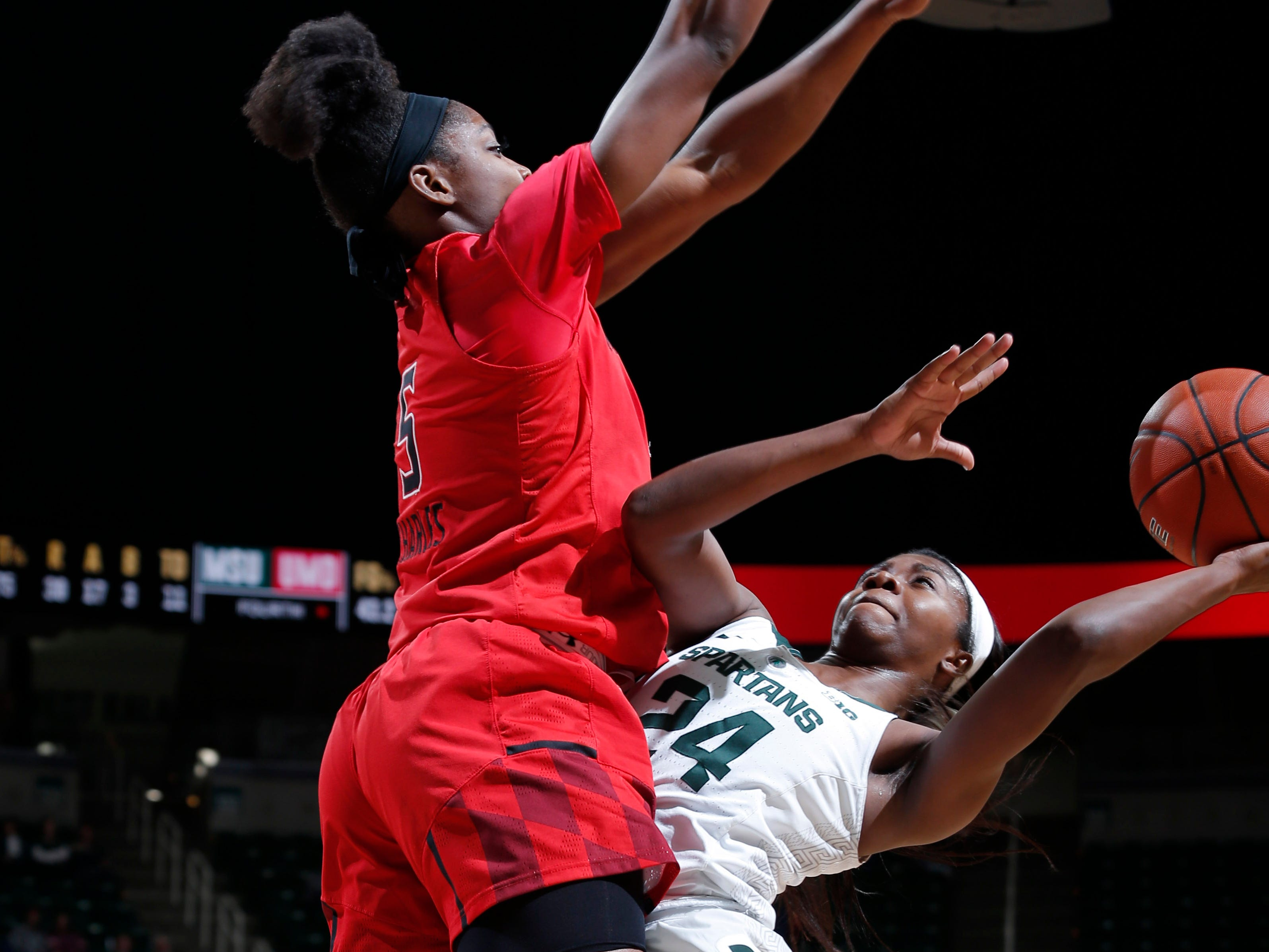 Michigan State's Nia Clouden, right, is fouled by Maryland's Kaila Charles, Thursday, Jan. 17, 2019, in East Lansing, Mich.