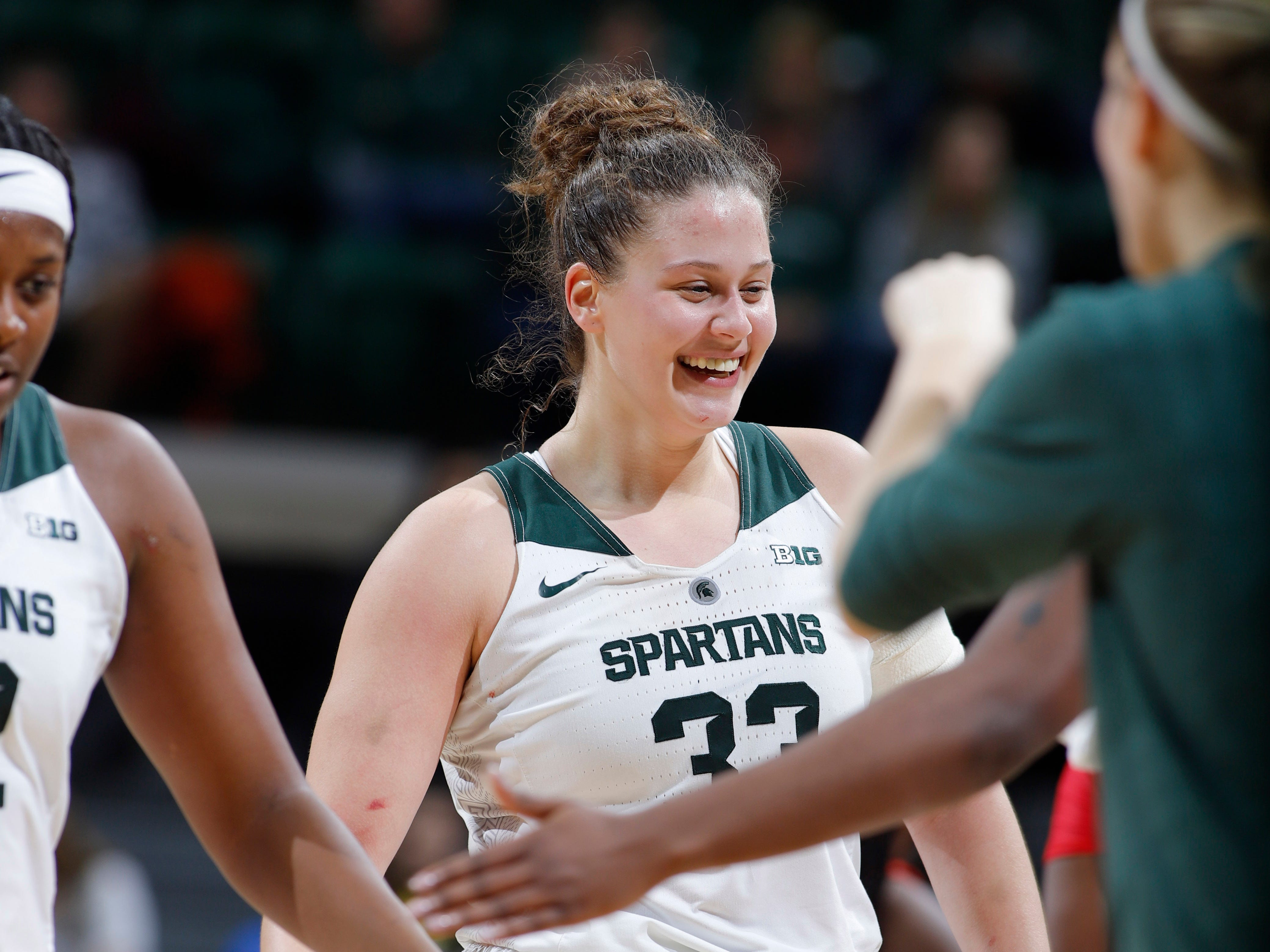 Michigan State's Jenna Allen celebrates with teammates against Maryland, Thursday, Jan. 17, 2019, in East Lansing, Mich.