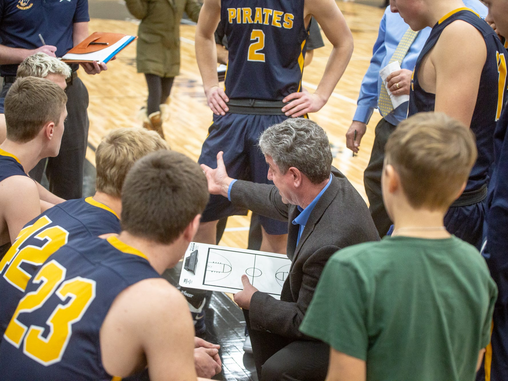 Pewamo-Westphalia coach Luke Pohl talks strategy during a time out Thursday,  Jan. 17, 2019.