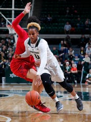 Michigan State's Shay Colley drives against Maryland, Thursday, Jan. 17, 2019, in East Lansing, Mich.