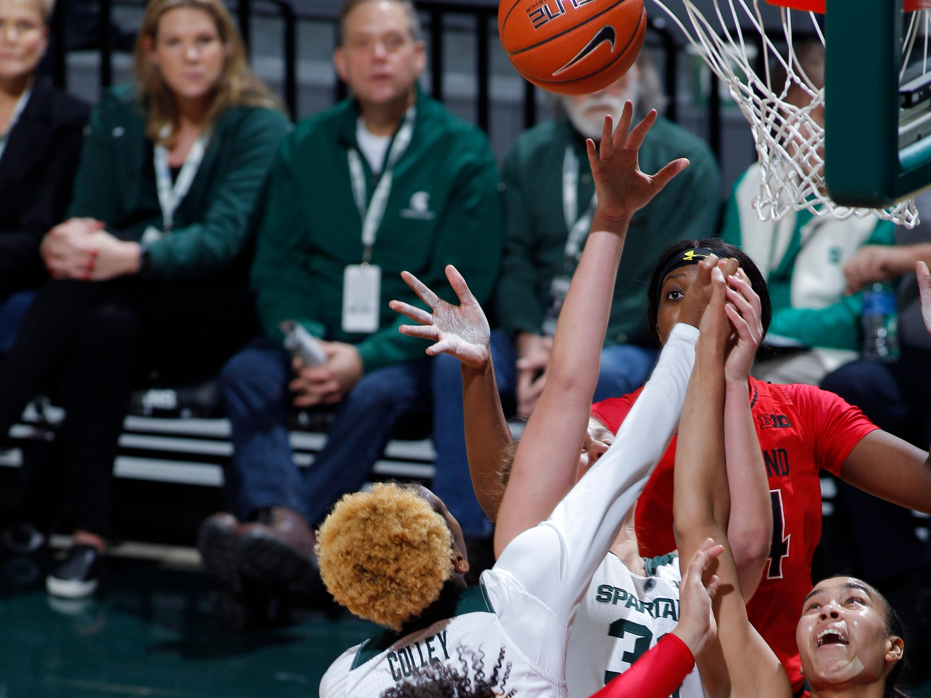 Michigan State's Jenna Allen, center, and Shay Colley, center left, and Maryland's Kaila Charles (5), Blair Watson (22) and Stephanie Jones (24) vie for a rebound, Thursday, Jan. 17, 2019, in East Lansing, Mich.