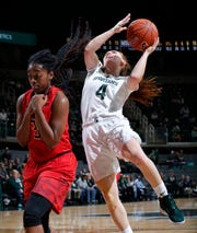 Michigan State's Taryn McCutcheon, right, goes up for a layup against Maryland's Brianna Fraser, Thursday, Jan. 17, 2019, in East Lansing, Mich.