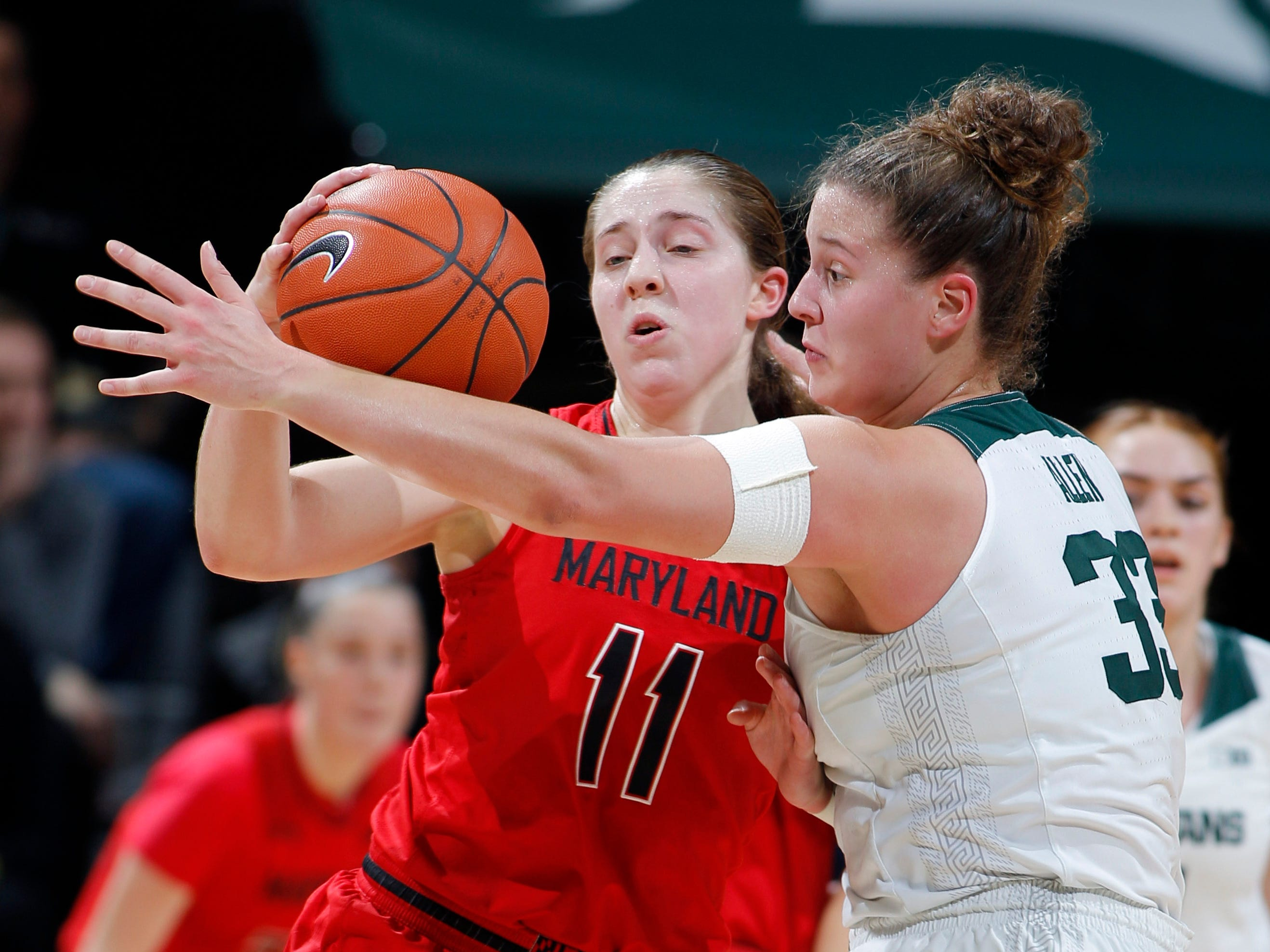 Michigan State's Jenna Allen, right, tries for a steal against Maryland's Taylor Mikesell, Thursday, Jan. 17, 2019, in East Lansing, Mich.