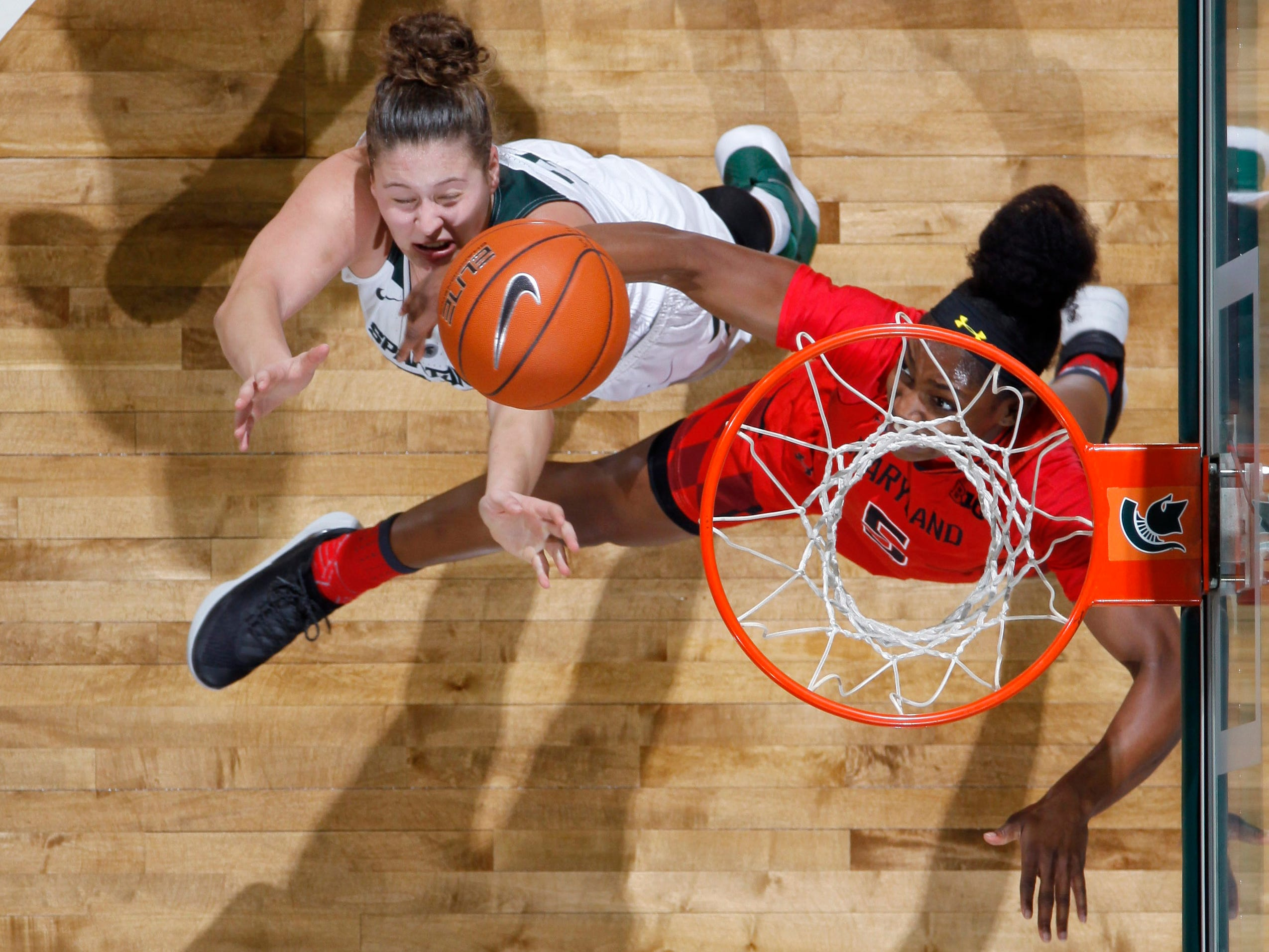 Michigan State's Jenna Allen, left, and Maryland's Kaila Charles fight for a rebound, Thursday, Jan. 17, 2019, in East Lansing, Mich.