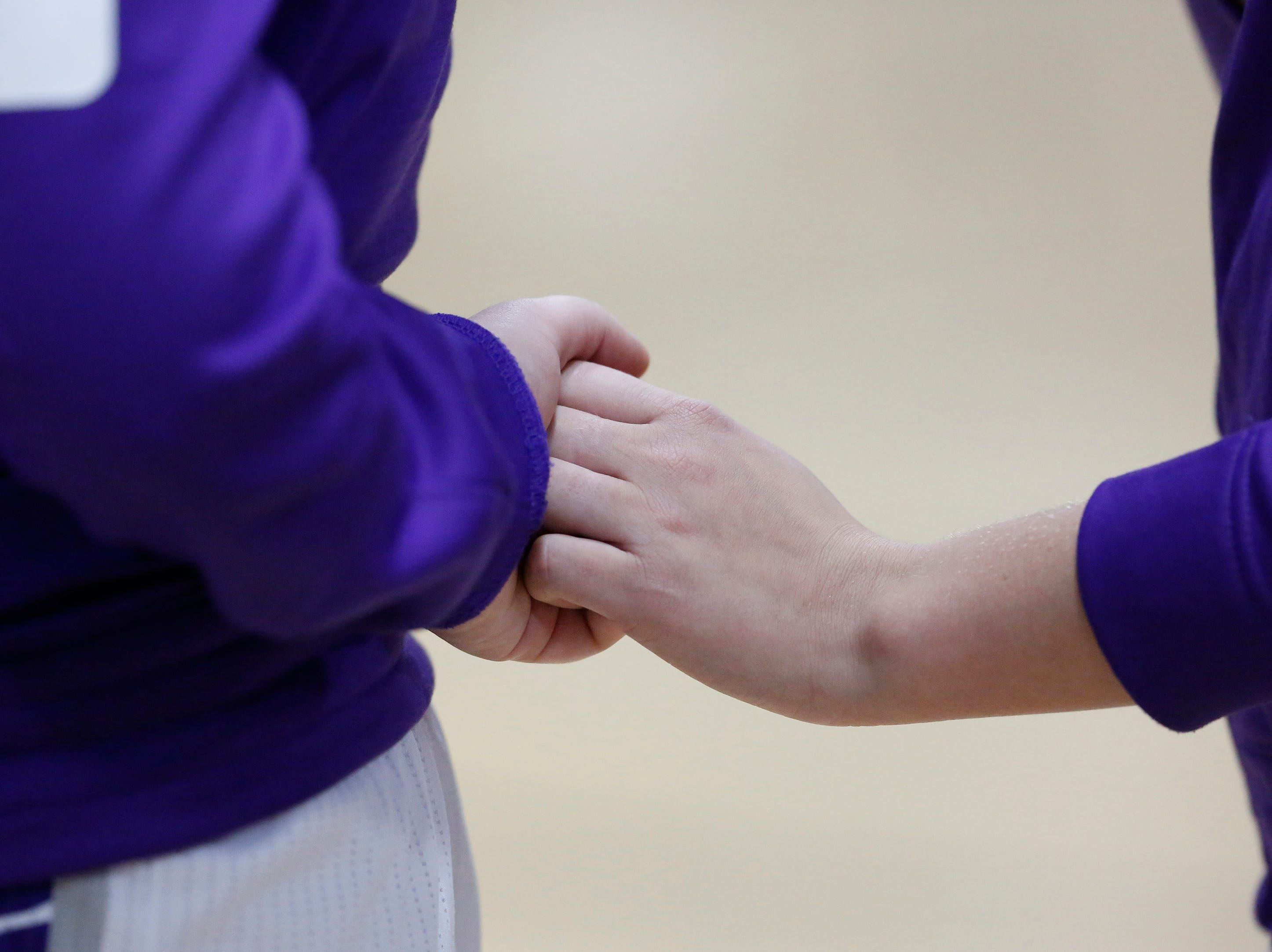 Kiel's girls basketball teammates hold hands during the National anthem before an EWC matchup against Roncalli at Kiel High School Thursday, January 17, 2019, in Kiel, Wis. Joshua Clark/USA TODAY NETWORK-Wisconsin