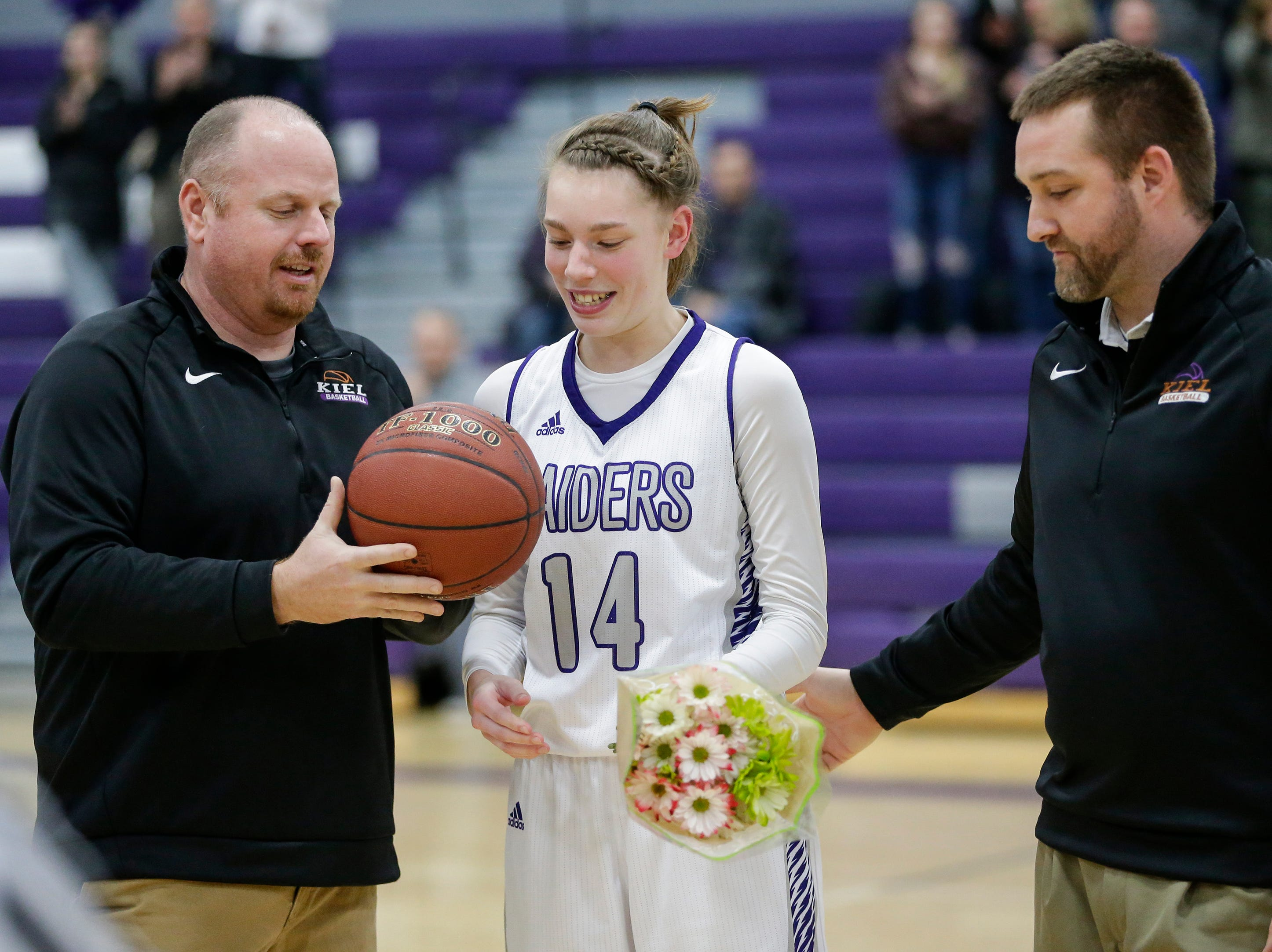 Kiel's Savannah Walsdorf (14) is recognized for being the Raiders' first girl basketball player to join the 1,000 point club before an EWC matchup against Roncalli at Kiel High School Thursday, January 17, 2019, in Kiel, Wis. Joshua Clark/USA TODAY NETWORK-Wisconsin