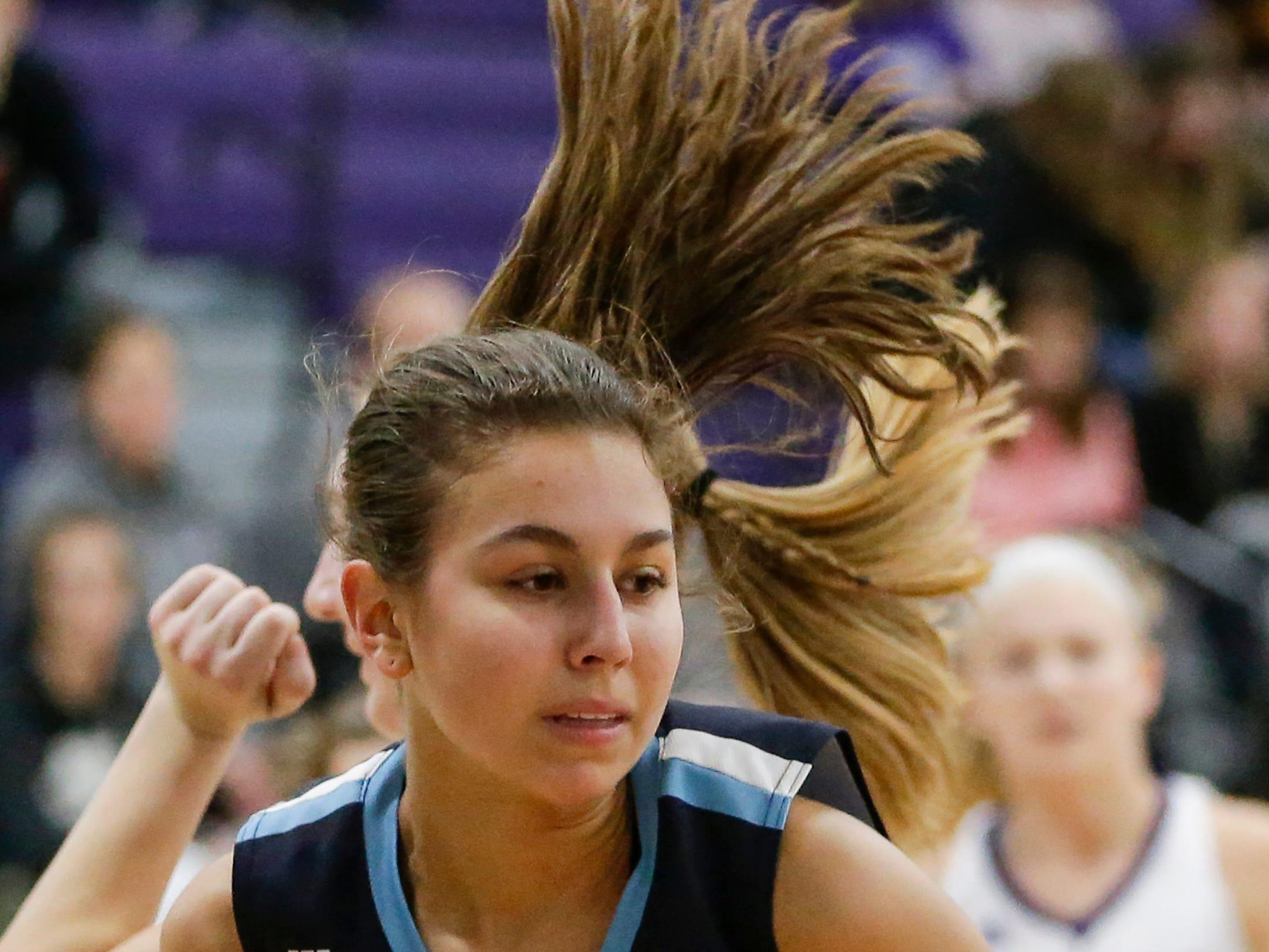 Roncalli's Megan Moczynski (12) rebounds against Kiel during an EWC matchup at Kiel High School Thursday, January 17, 2019, in Kiel, Wis. Joshua Clark/USA TODAY NETWORK-Wisconsin