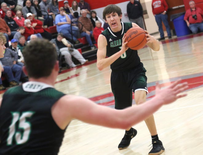 Clear Fork's AJ Blubaugh passes the ball to Jay Swainhart while playing at Shelby earlier in the season.