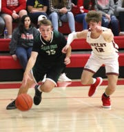 Clear Fork's Brady Tedrow dribbles the ball in front of Shelby's Grant Gossom on Thursday.