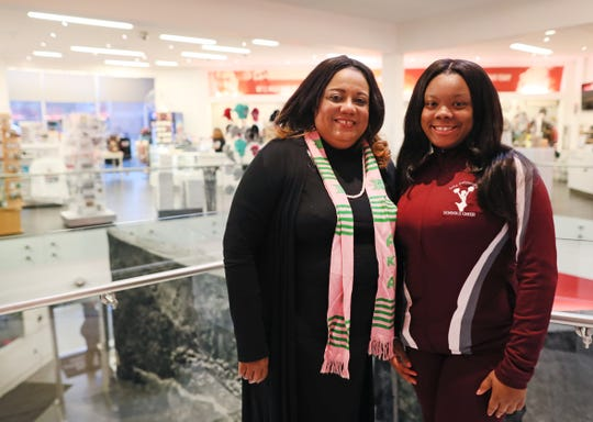 Rosemary Winters, 51, stands with her daughter Karmen, 17, inside the National Civil Rights Museum where she has volunteered at the children's' tent on Martin Luther King Jr. Day for the last 10 years, while Karmen has joined her, volunteering since she was 12.