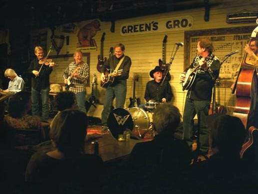 The Homer Dever Band has as much fun on stage as the folks in the audience.  From left, Steve Hinson, Hank Singer, Reggie Young, Aubrey Preston, Richie Albright, Ron Rigsby and David Smith.