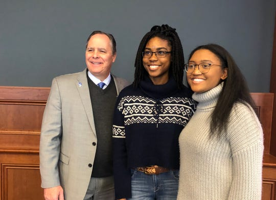 University of Memphis President M. David Rudd with Folds of Honor scholarship recipients Raven Covington, center, and Yasmen Stinson, right.