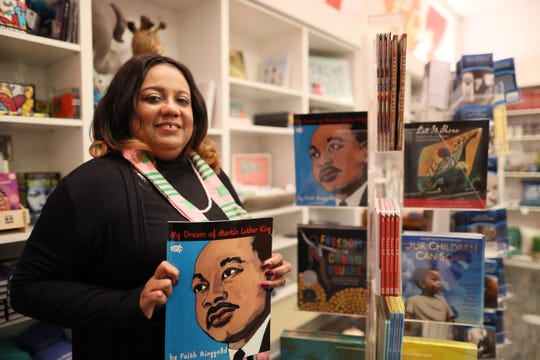 Rosemary Winters, 51, holds a copy of a book she reads to students at the National Civil Rights Museum, where she has volunteered at the children's' tent on Martin Luther King Jr. Day for the last 10 years.