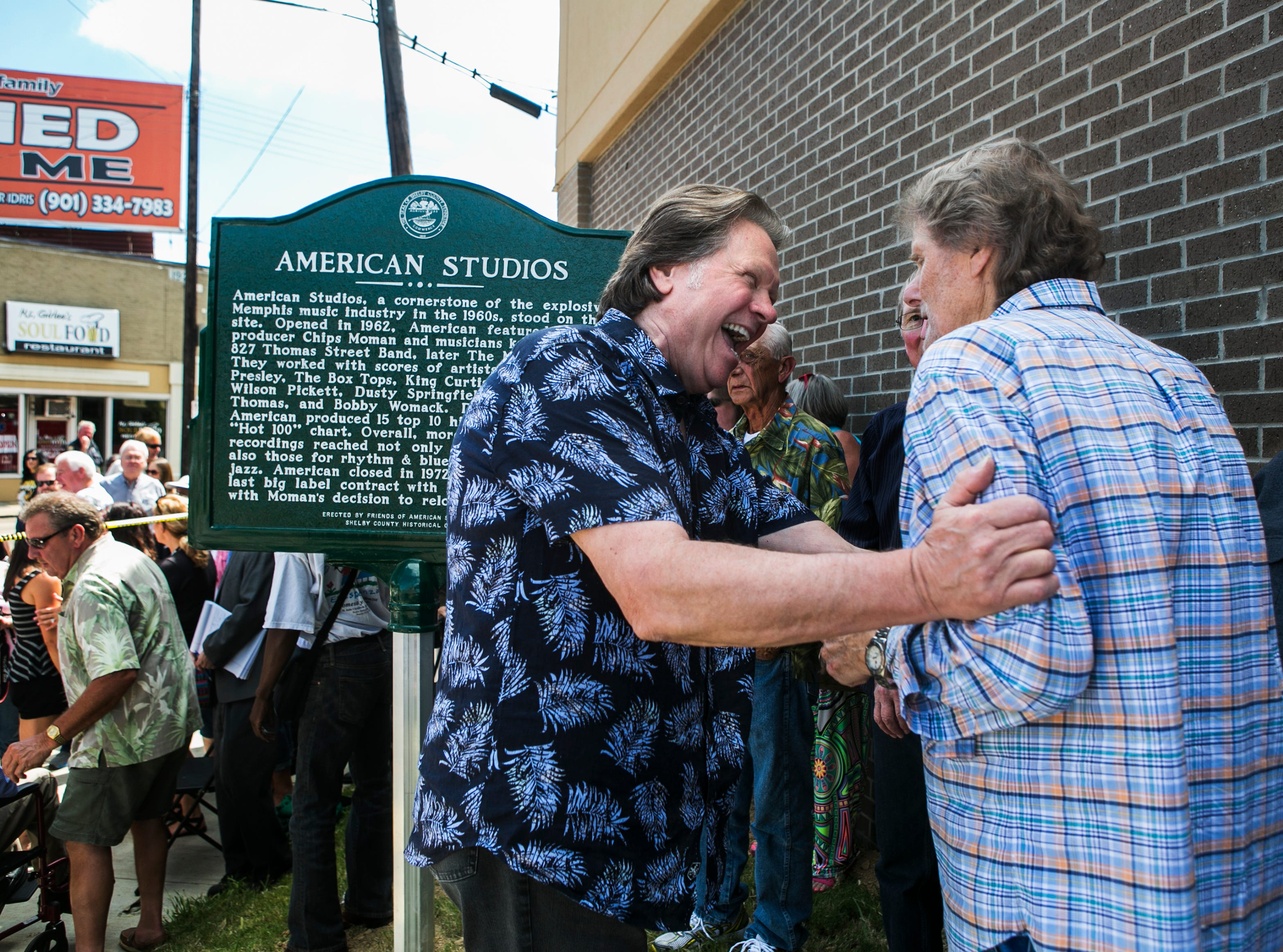 "August 13, 2014 - Songwriter Mark James, who penned Elvis Presley's hit ""Suspicious Minds"", embraces Reggie Young, guitarist of American Sound Studios Band, during the unveiling of the American Studios historical marker at 831 Thomas Wednesday afternoon."