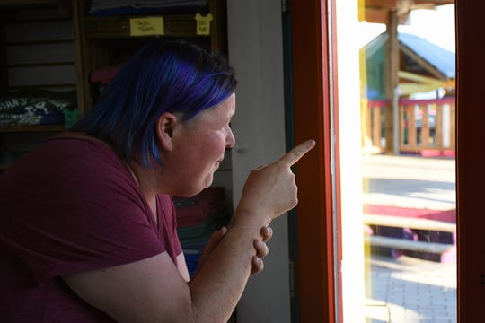 Inside the Island Woman, Amanda Baldwin points out where the Buzzard Lope contestants dance during the annual Mullet Festival. The tiny fishing village of Goodland will host three public events the weekend of Jan. 25 through 27.