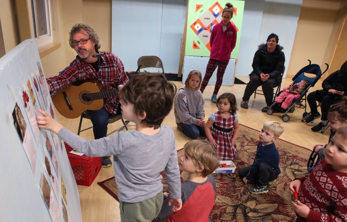 Zachary King, 5, picks out a song for Nick Meske to plays during a free parent and child music class on Jan. 17 Meske offered as a promotion for a six-week class through the Oconomowoc Recreation Department at the Community Center.