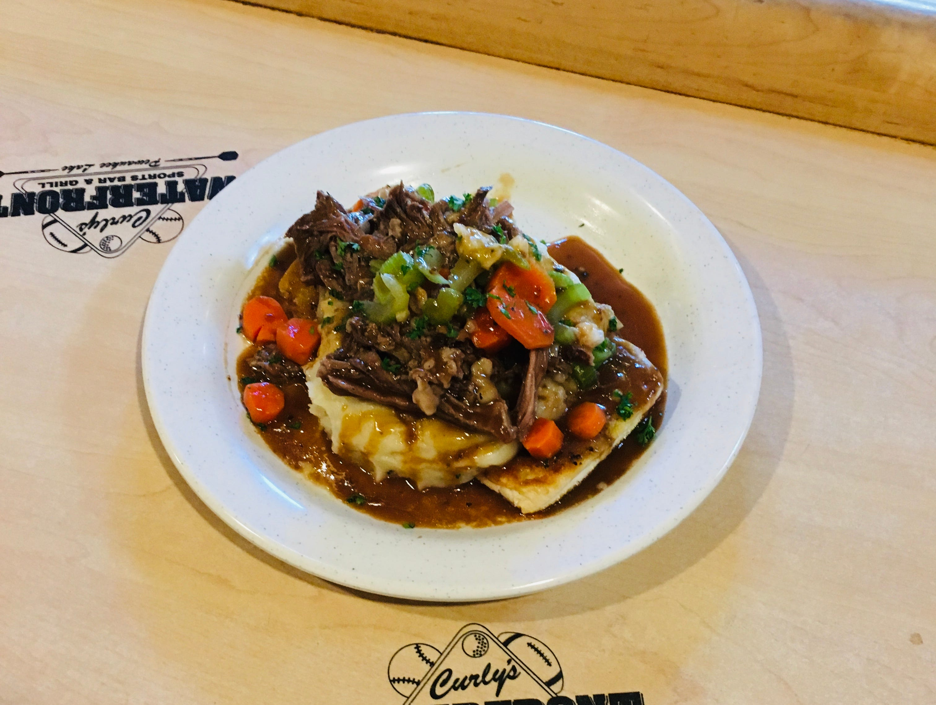 Curly's serves up plenty of hearty entrees including the pot roast.