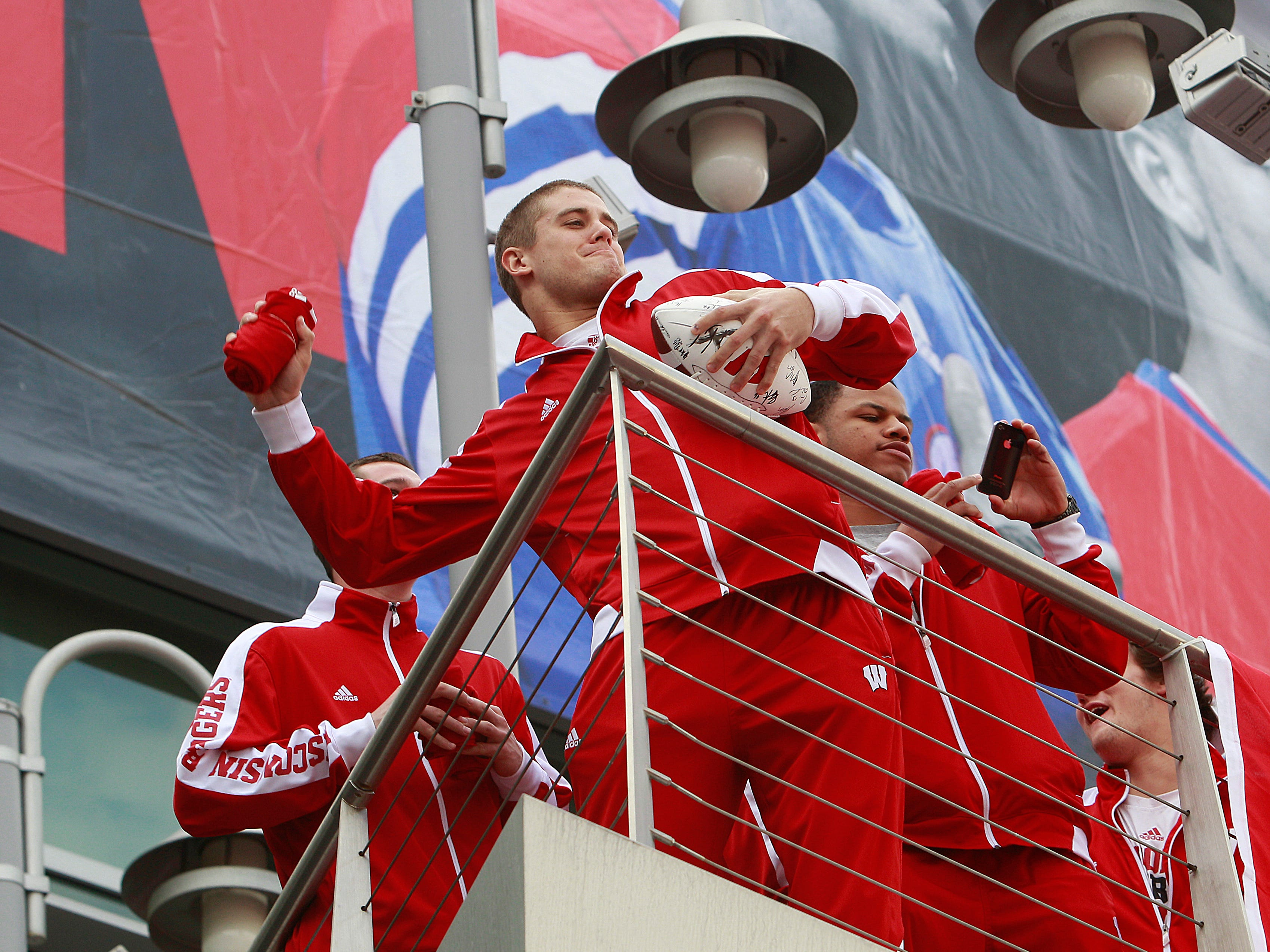 Wisconsin's Derek Watt throws a shirt into the crowd of about 2,000 Badger fans that gather at a Wisconsin pep rally at LA Live in downtown Los Angeles on Sunday, Dec. 30, 2012.