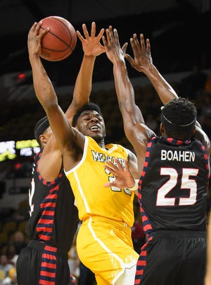 Darius Roy (shown in a previous game) had 20 points and 10 rebounds for the Panthers on Thursday night.