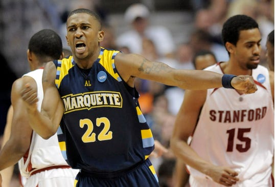 Marquette's Jerel McNeal reacts to scoring against Stanford during the second half of their second round basketball game at the NCAA South Regional on Saturday, March 22, 2008 in Anaheim, Calif.