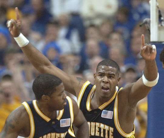 Robert Jackson reacts to two of his points over Kentucky. Marquette advances to the final four.