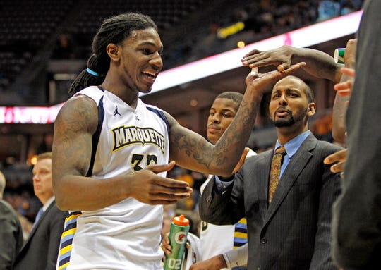 Jae Crowder is congratulated for  his 27 points during the Marquette 82-65 win over Rutgers during the Marquette-Rutgers Big East basketball  game at the Bradley Center in Milwaukee, Wisconsin, Wednesday, February 22,  2012.