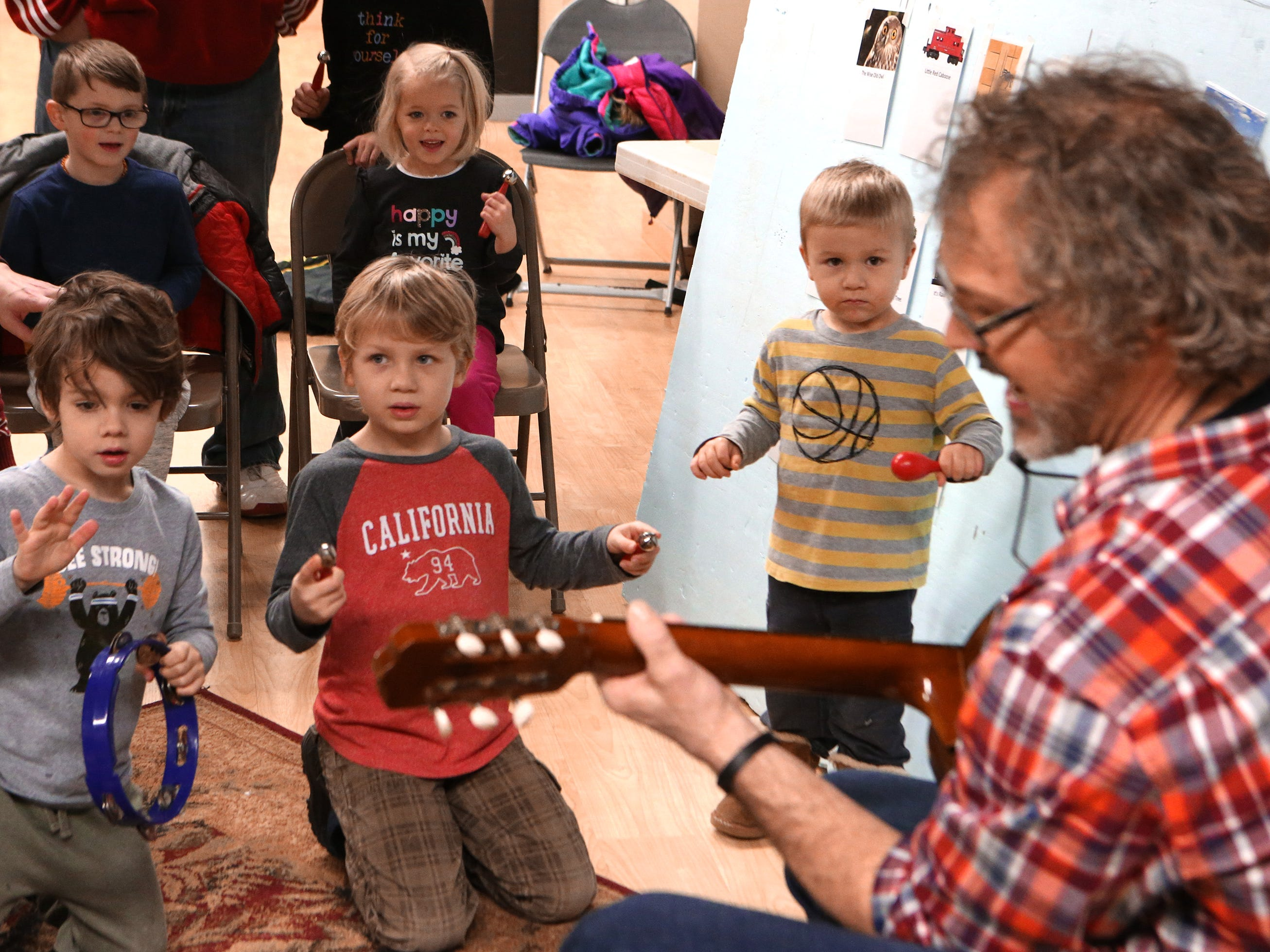 Children play hand instruments along with Nick Meske during a free parent and child music class on Jan. 17 as a promotion for a six-week class to be offered through the Oconomowoc Recreation Department at the Community Center.
