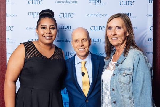 Oconomowoc resident Lori Jemison (right) was named one of CURE Media Group's 2018 MPN Heroes. Olympic champion Scott Hamilton (center) was the keynote speaker at the ceremony in San Diego.