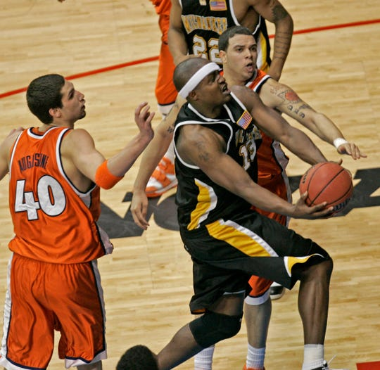 UWM's Joah Tucker goes up for a basket against  Illinois' James Augustine and Deron Williams at the Allstate Arena in Rosemont, IL Thursday, March 24, 2005.