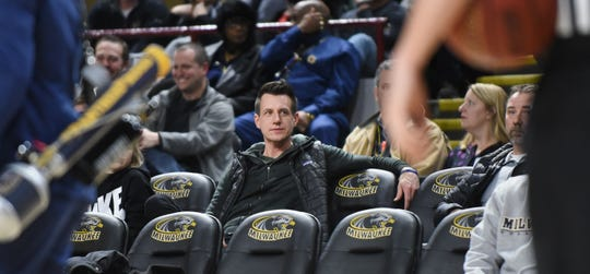 Milwaukee Brewers manager Craig Counsell takes in a UW-Milwaukee victory.