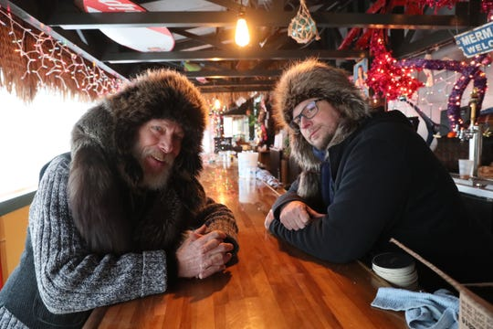 "Even an ice bar can be cozy. Patrick Nedobeck ""King of the Ice Bars"" (left) and bartender Chris Lehmkuhl (right) prepare for a night of hard work at the St. Paul Fish Co. ice bar, which opened Jan. 18."
