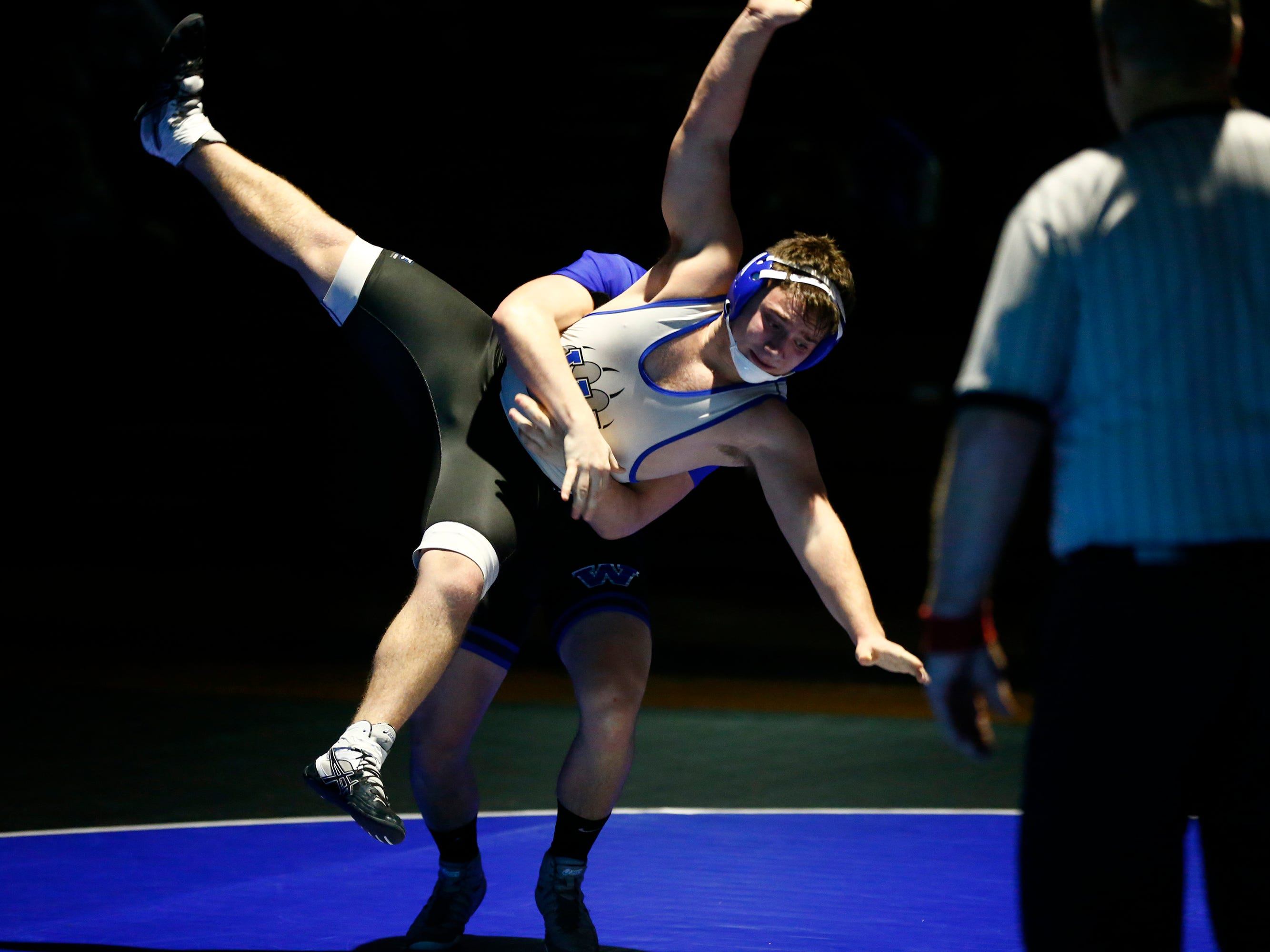 Waukesha West's Logan Anderson is thrown to the mat and pinned by Watertown's Dylan Sippel in a 170-pound match during a dual meet at West on Jan. 17.