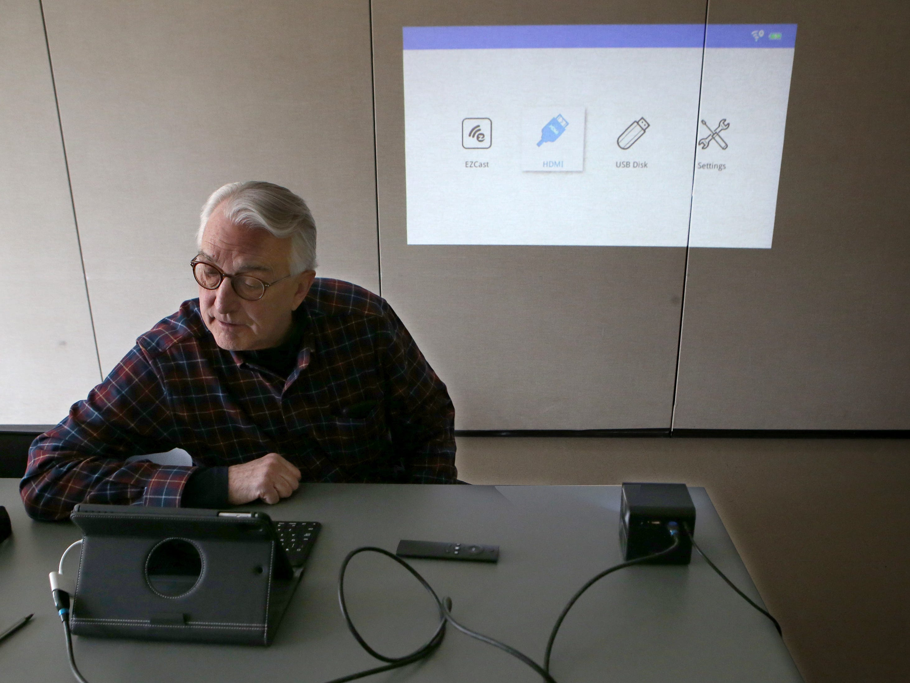 Peter Lee demonstrates a recently released GoSho portable high-definition projector that can connect to touch devices and computers during a gathering of If It Goes Beep, an informal discussion and problem solving group that meets at 9 a.m. Fridays at the Shorewood Senior Resource Center. The Center also offers One-to-One Tech Support Fridays from 9 a.m. to 11:30 a.m. for people to stop in with their technology questions.