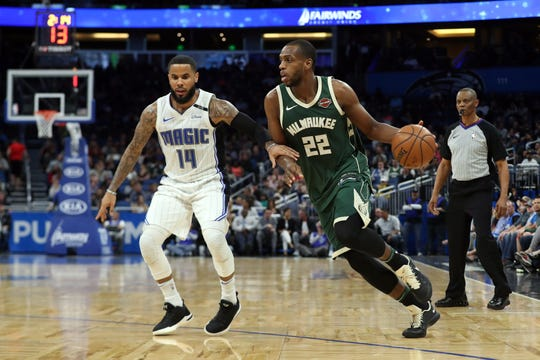 Bucks forward Khris Middleton drives to the basket against Magic guard D.J. Augustin during a game at Amway Center in 2018.  Middleton and the Bucks face their fifth road test over the past six games, including their game Saturday in Orlando.