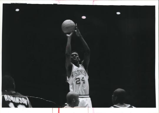 Michael Finley skies for a shot in 1993.