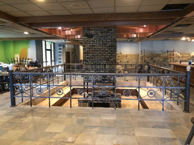 A fire pit surrounded by bench seating recessed below the main floor is expected to be a centerpiece attraction for Ella's Public House, under construction in part of the space formerly occupied by the former 18 West Sports Grille and Banquets in the town of Genesee.