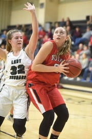 Norfork's Kynzie Rangel goes up for two against Izard County's Bethany Simmons on Thursday night.