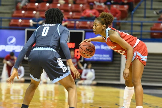 Louisiana Tech sophomore guard Amber Dixon (10) examines the floor versus Old Dominion in a Conference USA game Thursday night at the Thomas Assembly Center.