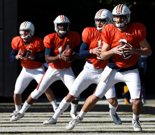 Auburn quarterbacks (from left to right) Cord Sandberg, Malik Willis, Joey Gatewood and Jarrett Stidham practice before the Music City Bowl on Monday, Dec. 24, 2018 in Nashville, TN. Todd Van Emst/AU Athletics