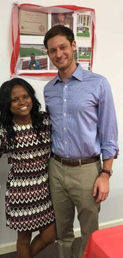 Deshay Mckinney with Phillip Ensler at her graduation party in 2016. Ensler, the founder of the Marching On program, is her mentor, Mckinney said.