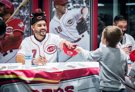 Cincinnati's Eugenio Suarez signs autographs during the Reds Caravan at Stoops Automotive Thursday night.