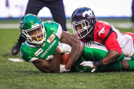 Saskatchewan Roughriders wide receiver Jordan Williams-Lambert (84) carries the ball during the second half against Calgary Stampeders during a Canadian Football League game Aug 19, 2018 in Regina, Saskatchewan, Canada at Mosaic Stadium.