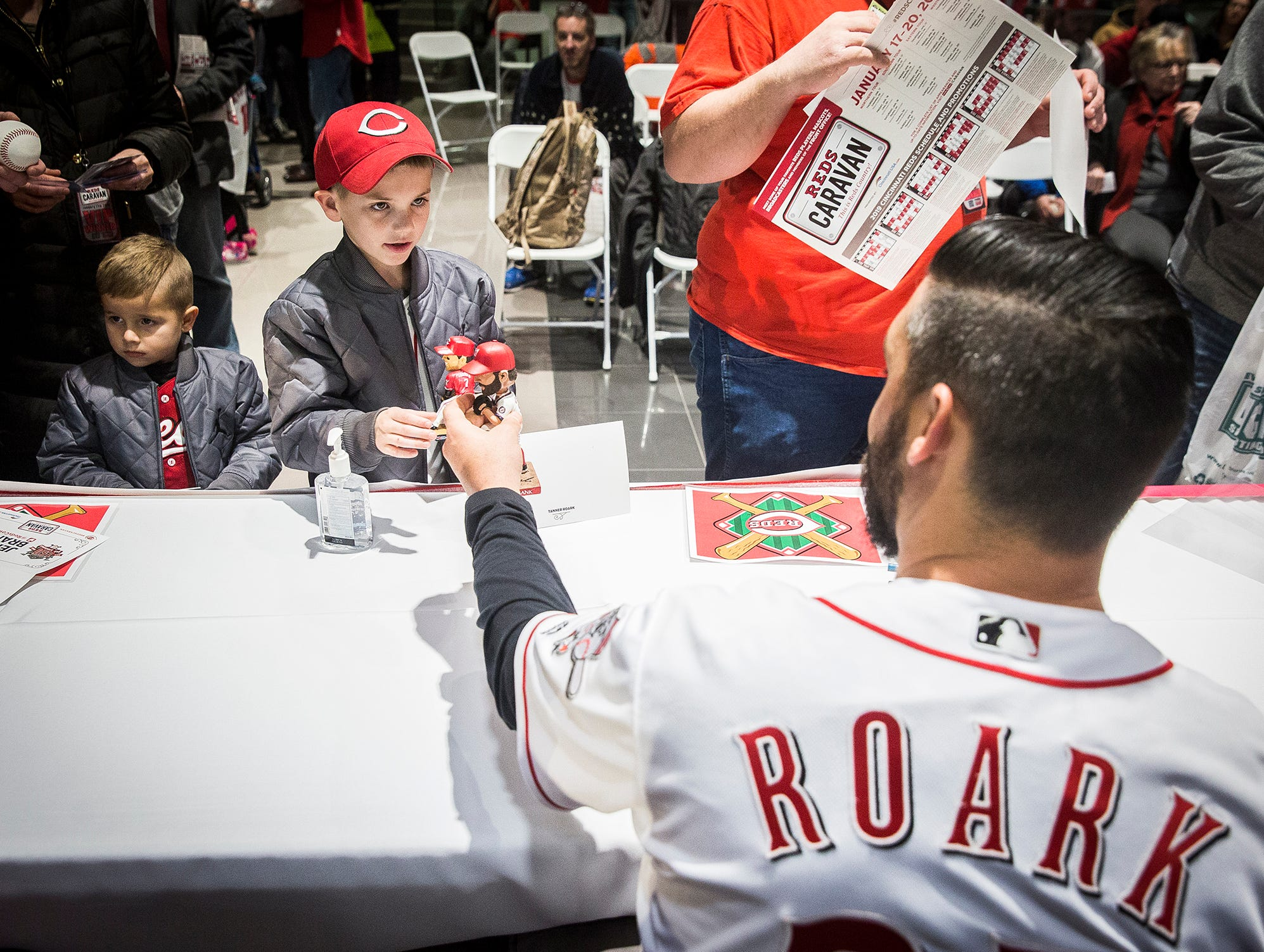 The Reds Caravan returned to Muncie at Stoops Automotive on Clara Lane Thursday evening. Broadcasters Jeff Brantley and Jim Day,  pitcher Tanner Roark, third- baseman Eugenio Suárez,, minor league catcher Tyler Stephenson, President of Baseball Operations Dick Williams, and mascot Rosie Red signed autographs and answered questions during the event.