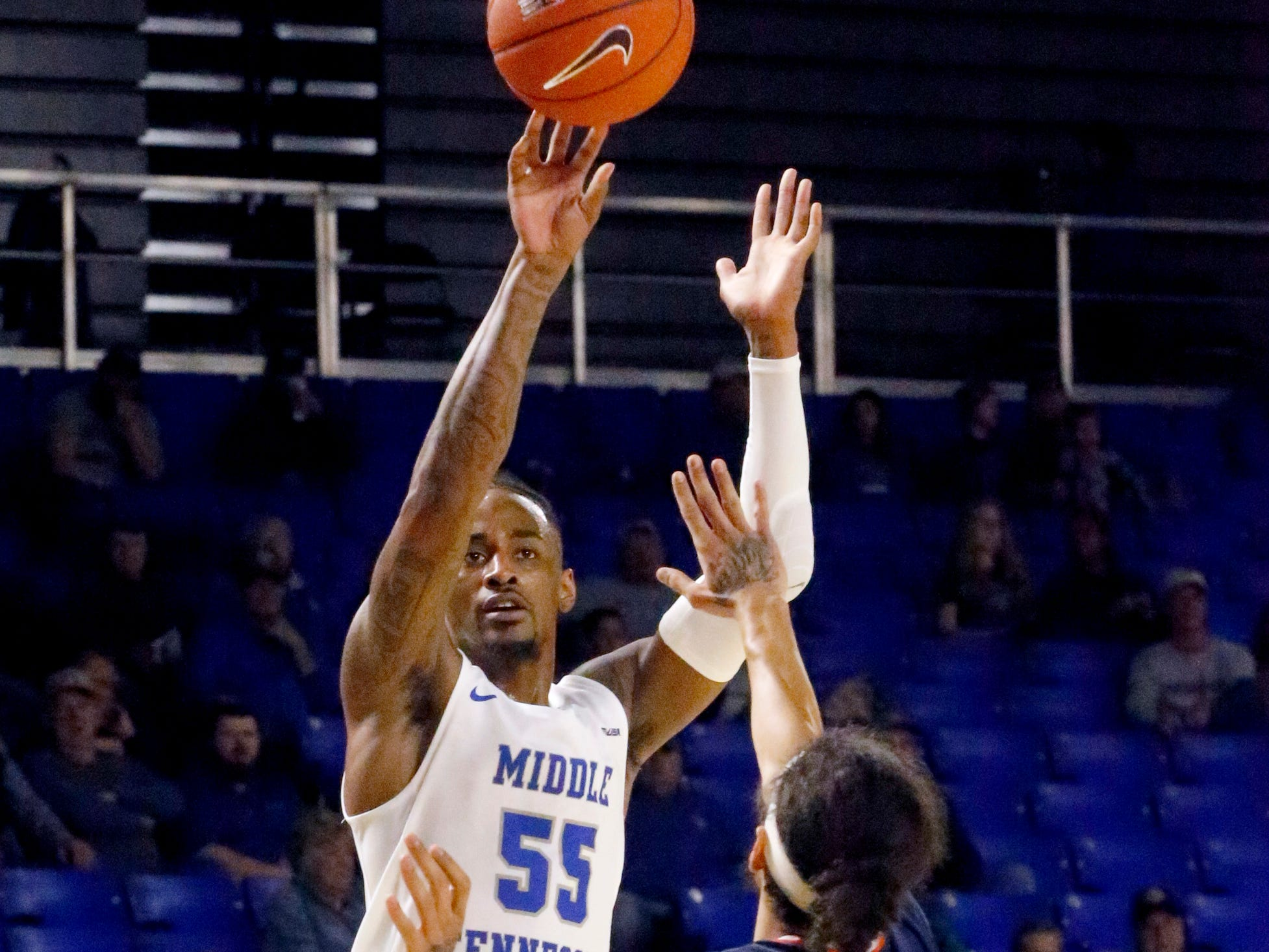 MTSU's guard Antonio Green (55) goes for a three point basket as UTSA's guard Jhivvan Jackson (2) guards him on Thursday Jan. 17, 2019.
