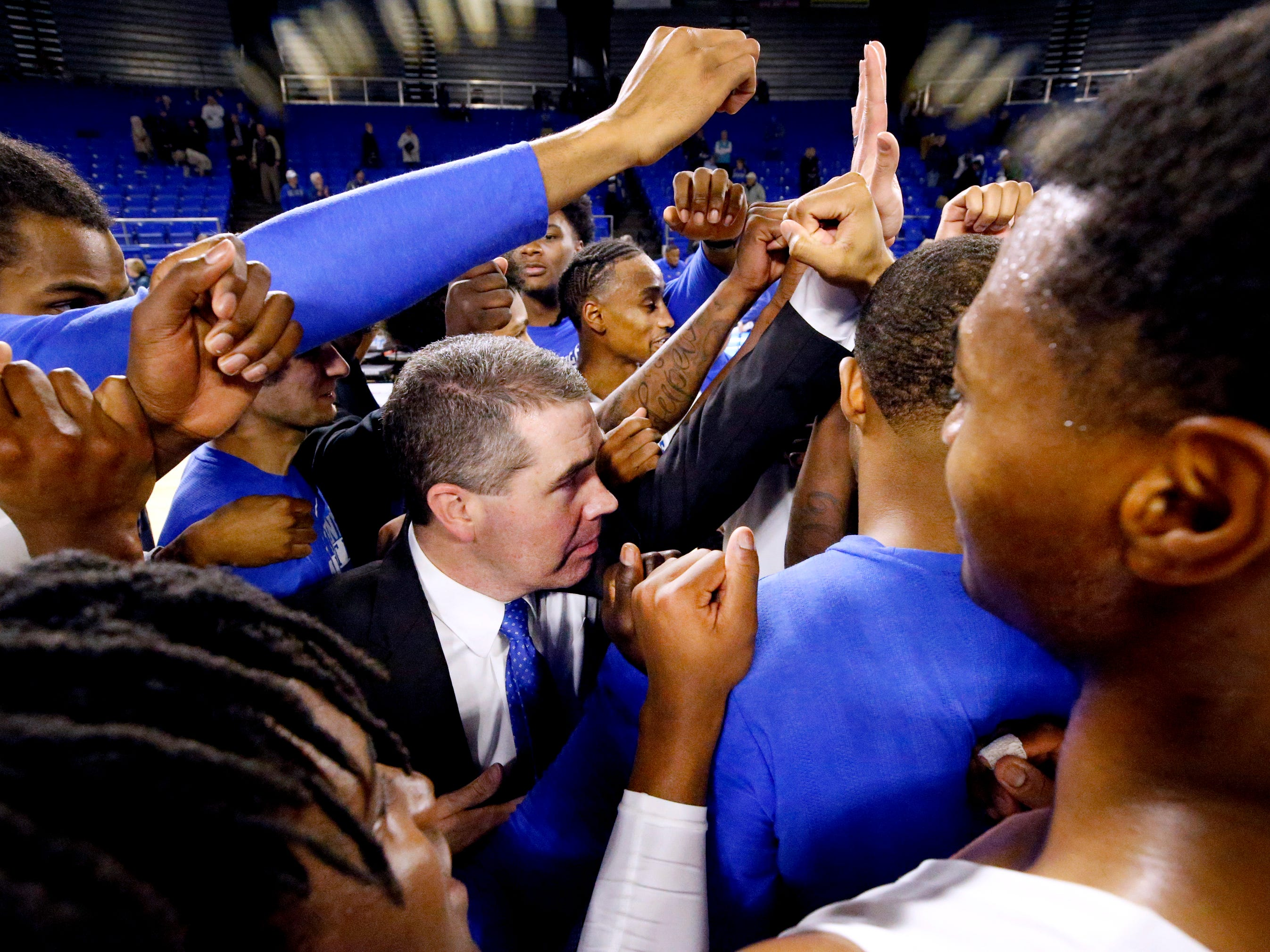 MTSU's head coach Nick McDevitt celebrates the 89-86 win over UTSA on Thursday Jan. 17, 2019, after the game.