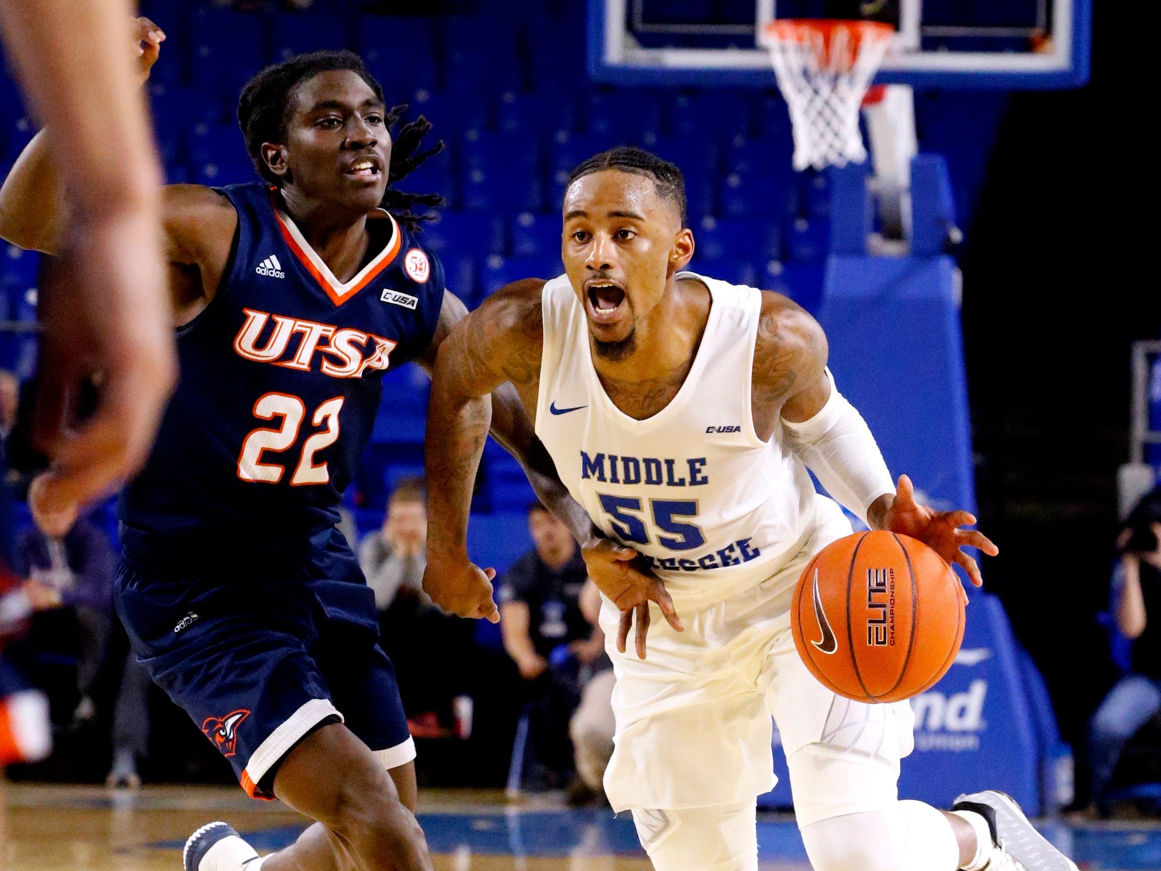MTSU's guard Antonio Green (55) brings the ball down the court as UTSA's guard Keaton Wallace (22) guards him on Thursday Jan. 17, 2019.